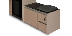 Larak seating filing cabinet offers two drawers on the right side and a file archiving drawer on the left. It is equipped with a seating cushion.